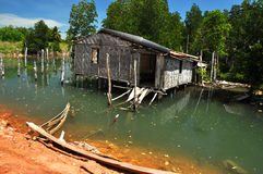 Ruined house, Thailand. Isolated dilapidated dwelling in a bay Stock Photos