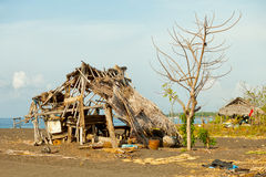Ruined hut on the beach. Indonesia, Bali Royalty Free Stock Photos