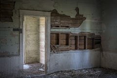 Ruined interior of an old abandoned school house Royalty Free Stock Image