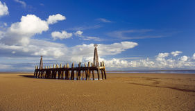 Ruined landing stage, Lytham st Annes. This isolated structure on the Lancashire coast, at Lytham st Annes, was once a landing stage for pleasure craft, and Royalty Free Stock Photos