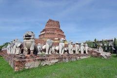 Ruined lion statue around damaged pagoda in Ayutthaya Thailand Royalty Free Stock Image