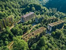 Ruined lost overgrown mining ghost town Akarmara, consequences of war in Abkhazia, aerial view from drone royalty free stock photo