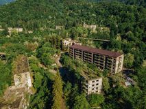 Ruined lost overgrown mining ghost town Akarmara, consequences of war in Abkhazia, aerial view from drone royalty free stock images