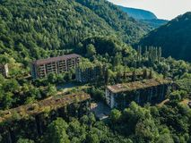 Ruined lost overgrown mining ghost town Akarmara, consequences of war in Abkhazia, aerial view from drone royalty free stock photography
