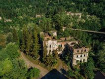 Ruined lost overgrown mining ghost town Akarmara, consequences of war in Abkhazia, aerial view from drone.  royalty free stock photos