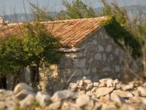 Ruined mediaeval sheppard Cottage and stone fence. In island Krk, Croatia Stock Photos