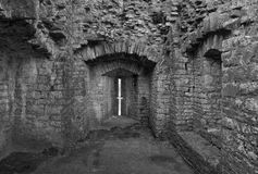 Ruined medieval castle defensive arrow slit Stock Image