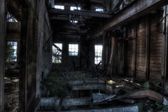 Ruined mill. Abandoned and ruined mill wood Royalty Free Stock Photo