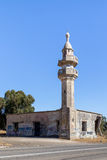 The ruined mosque with the minaret remaining after the war of the Judgment Day Yom Kippur War on the Golan Heights, near the bor Stock Photos
