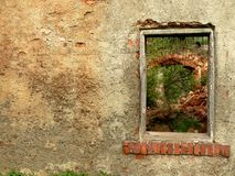 Ruined  old house. The wall and window in ruined old house. Place for text on left side Royalty Free Stock Images