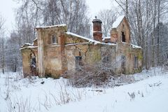 Ruined old house. In the winter forest Royalty Free Stock Images