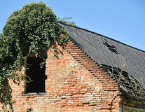 Ruined old house wall and roof Royalty Free Stock Photo