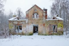 Ruined old house. In the winter forest Stock Photos