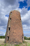 Ruined old mill tower. Photo of old mill, silo for crops, devastated but still standing stock photos