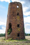 Ruined old mill tower. Photo of old mill, silo for crops, devastated but still standing stock image