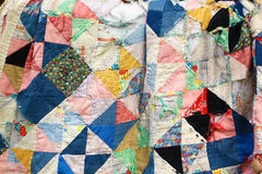 Ruined old-style quilt. Old and ruined old-style quilt blanket Stock Images