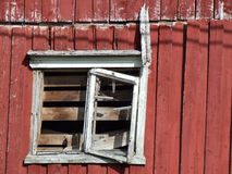 Ruined old wooden house window. Old building falling apart. Wooden construction Royalty Free Stock Photos