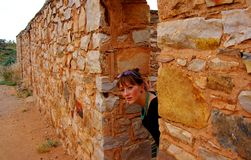 Ruined Outback Doorway. Photograph taken at Kanyaka Ruins near Hawker featuring a woman in a doorway in an ruined outback building (Flinders Ranges, South Stock Photography