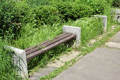 Ruined park bench Stock Photo