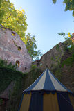 Ruined part of castle Neuenbuerg in Germany with a medieval tent Stock Images