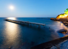 Ruined pier, Moon Path and evening coastline (Bulgaria). Royalty Free Stock Photography