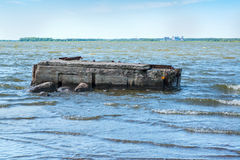Ruined pier in the sea Stock Photography