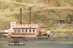 Ruined power station building at the abandoned Russian arctic settlement Pyramiden, Norway. stock photos