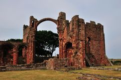 A ruined Priory, showing a Rainbow Archway. Royalty Free Stock Image