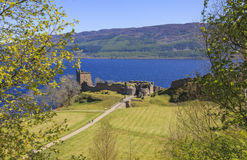 Ruined remains of Urquhart Castle in Loch Ness area. The magnificently situated Urquhart Castle, on the banks of Loch Ness, remains an impressive stronghold Royalty Free Stock Image