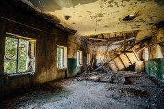 Ruined room, collapsed ceiling in abandoned building stock photos
