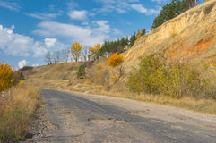 Ruined rural road in central Ukraine at fall season Stock Photos