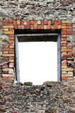Ruined rustic limestone boulder rubble wall masonry stonework ruins empty blank isolated red brick window aperture opening frame. Ruined rustic limestone boulder Royalty Free Stock Photos