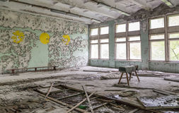 Ruined school gym with sports equipment remains in Pripyat Stock Photos