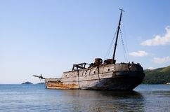 Ruined ship. Abandoned wooden ship laying near a coastline Stock Photography