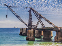 Ruined shipping crane Stock Photos