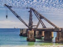 Ruined shipping crane Stock Photos
