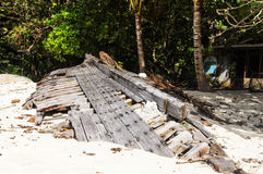 Ruined skeleton of an old boat on the shore of a tropical island. Pulau Perhentian, Malaysia Royalty Free Stock Image