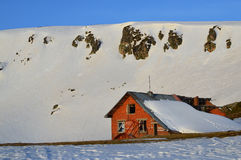 Ruined ski chalet in snowy mountains Stock Photography