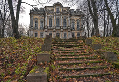 Ruined staircase and a palace Royalty Free Stock Photo