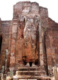 The ruined standing Buddha statue Stock Images