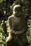 Ruined statue Ksitigarbha Bodhisattva Stock Photo