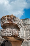 Ruined statue of Kukulcan at Venus Platform in Chichen Itza stock images