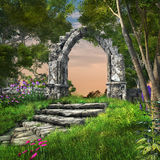 Ruined stone arch in the spring garden Royalty Free Stock Images