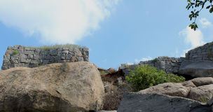 Ruined stone wall with sky Stock Photography