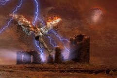 Ruined temple. Surreal digital art. Lightning strikes spooky ruins. Naked man with burning wings symbolizes fallen angel. Human elements were created with 3D Royalty Free Stock Image