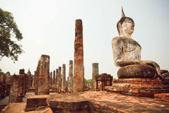 Ruined temple Wat Maha That with stone Buddha statues at Sukhothai historical park Royalty Free Stock Images