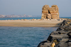 Ruined tower in front of the sea Stock Image