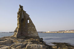 Ruined tower on the sea Stock Photos