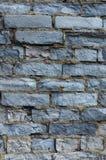 Ruined wall of brick gray. Royalty Free Stock Photography