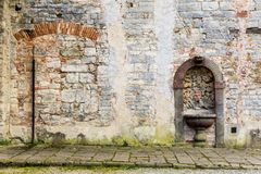 Ruined wall of a church. The ruined stone wall of an ancient church in Tuscany Stock Photos